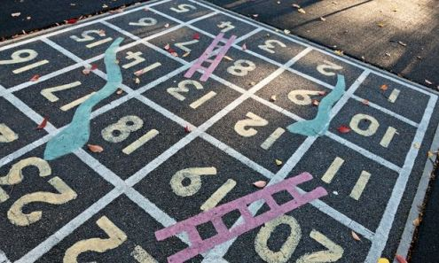 Snakes and ladders playground game